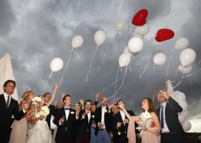 Bridal couple and guest with balloons