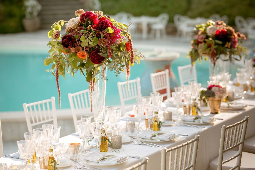 Wedding reception by the pool in Tuscany