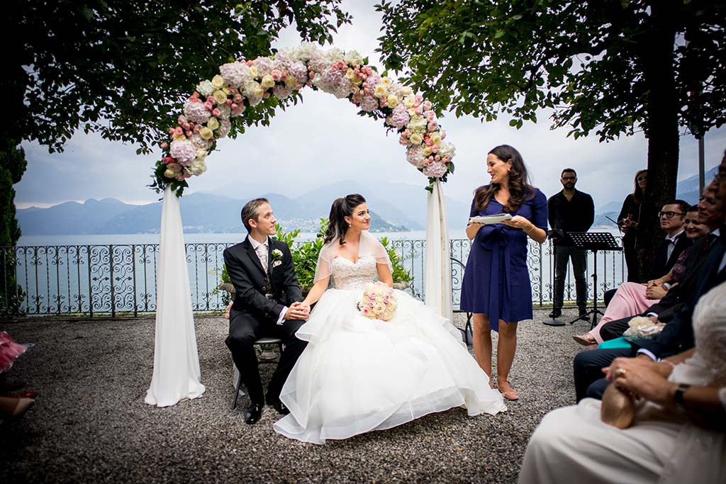 Bride and groom during wedding ceremony on Lake Como