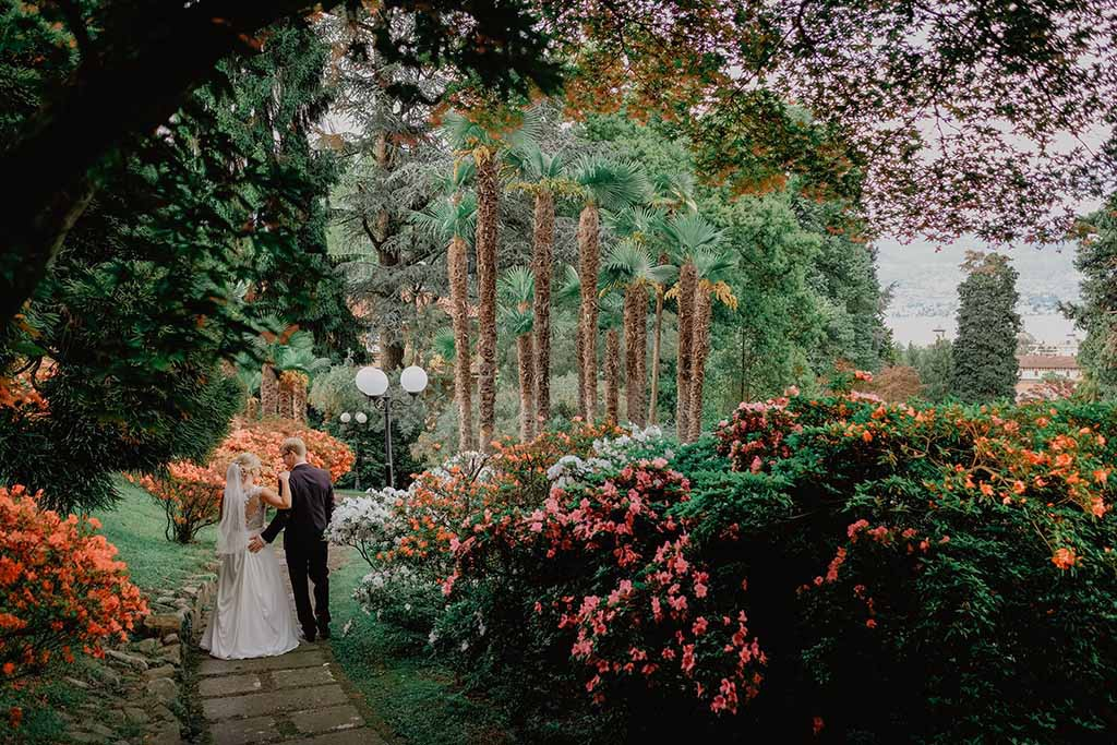 bridal couple in beautiful garden of villa on Lake Maggiore