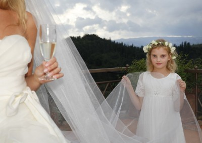Bride and flower girl at an outdoor wedding
