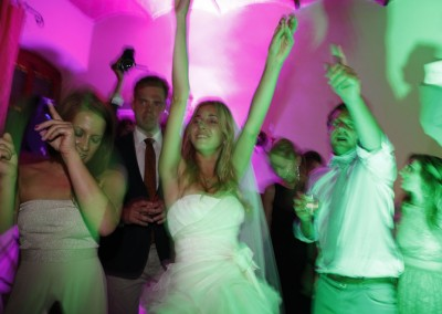 Bride and guests dancing at the wedding party
