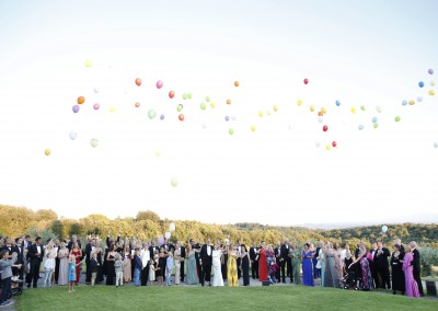 Bridal couple & guests with balloons