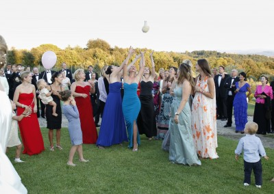 Bride and guests during the bridal bouquet toss