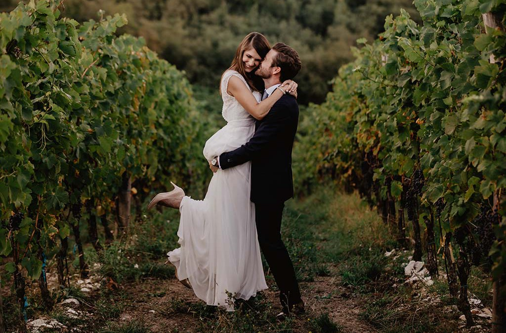 Couple in Tuscany in a vineyard